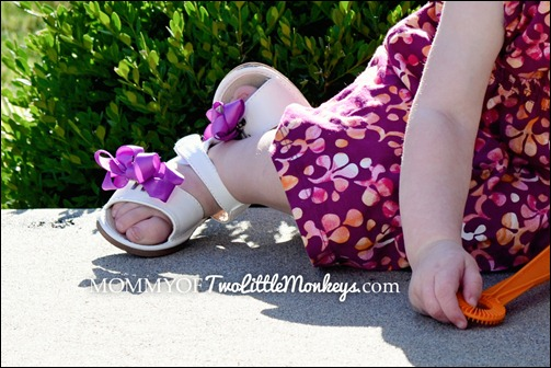 white sandals with purple bow