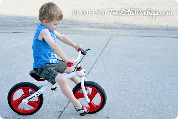 boy riding balance bike