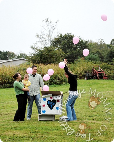 gender reveal party with pink balloons
