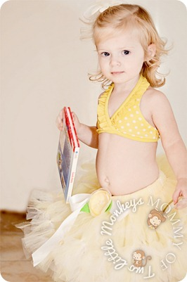 girl with book and hawaiian tutu