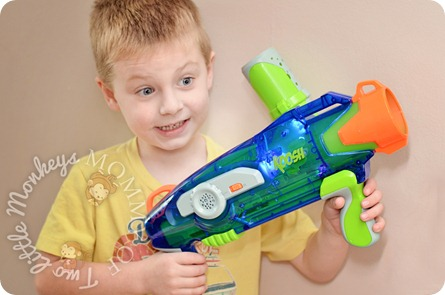 child playing with toy gun