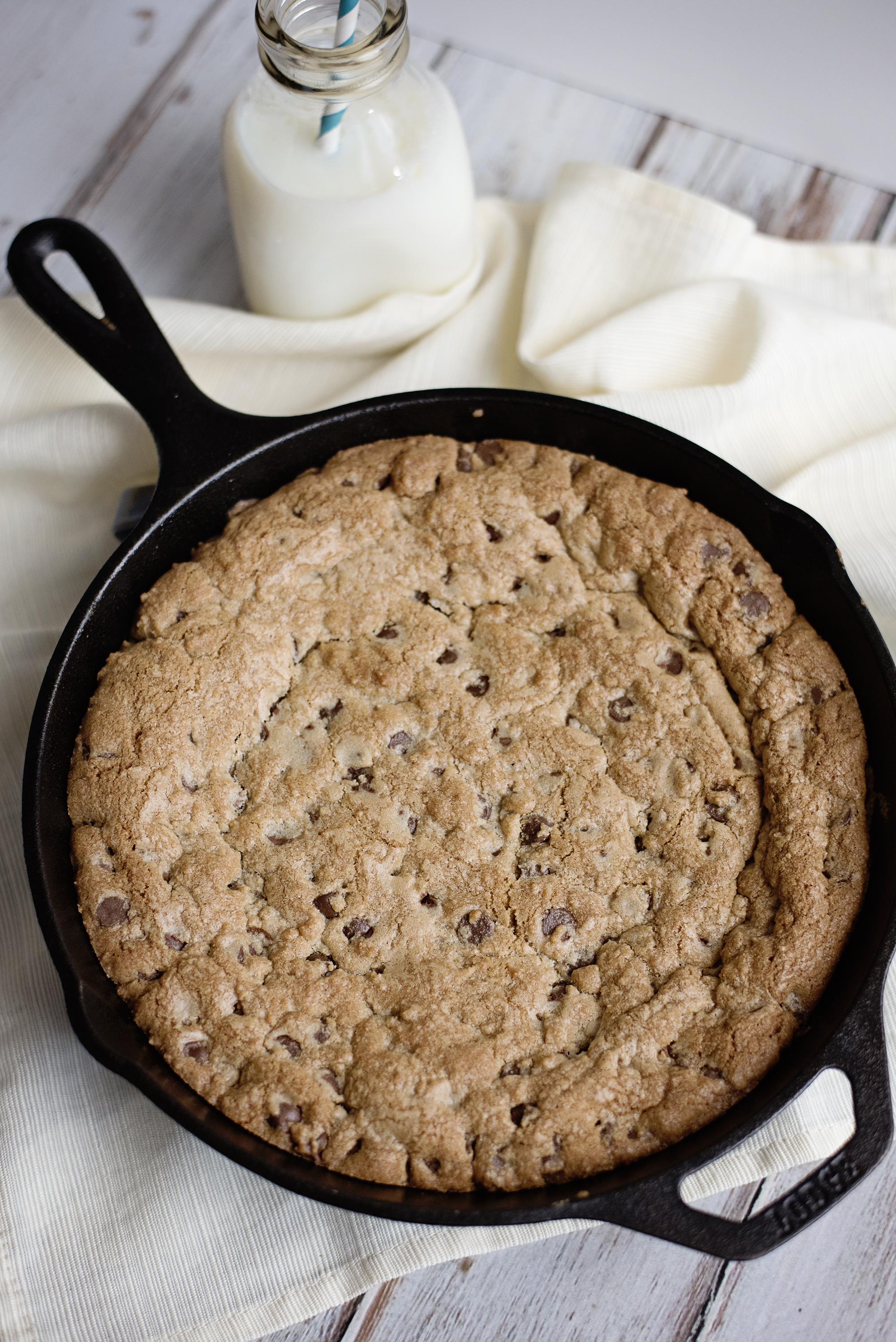 Skillet Cookie Cake - Restaurant Style! This recipe is seriously better than a birthday cake. Moist, delicious and easy to make.
